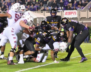 102215-01_a-gang-of-ecu-defenders-stuffs-a-temple-rushing-attempt